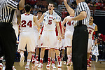 Wisconsin Badgers teammates Sam Dekker (15) and Bronson Koenig (24) celebrate during  a regional semifinal NCAA college basketball tournament game against the Baylor Bears Thursday, March 27, 2014 in Anaheim, California. The Badgers won 69-52. (Photo by David Stluka)