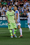CD Leganes's Unai Bustinza and FC Barcelona's Leo Messi during La Liga match between CD Leganes and FC Barcelona at Butarque Stadium in Madrid, Spain. September 26, 2018. (ALTERPHOTOS/A. Perez Meca)