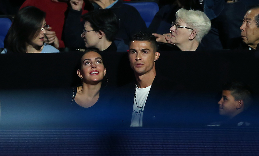 Cristiano Ronaldo sits in the corporate seats with his girlfriend Georgina Rodriguez<br /> <br /> Photographer Rob Newell/CameraSport<br /> <br /> International Tennis - Nitto ATP World Tour Finals Day 2 - O2 Arena - London - Sunday 12th November 2018<br /> <br /> World Copyright © 2018 CameraSport. All rights reserved. 43 Linden Ave. Countesthorpe. Leicester. England. LE8 5PG - Tel: +44 (0) 116 277 4147 - admin@camerasport.com - www.camerasport.com