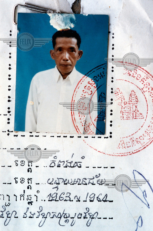 Comrade Duch posing as 'Hang Pin' on his biography from the education offices in Sisophon, Beantey Meanchey. The photograph was taken in the early 1990s. Duch (real name Kaing Guek Eav) was chief executioner of the Khmer Rouge, responsible for the S-21 detention centre at Tuol Sleng, where over 16,000 people were killed between 1975 and 1979. Photographer Nic Dunlop unearthed Duch working with the American Refugee Committee in 1999. He is currently awaiting trial.