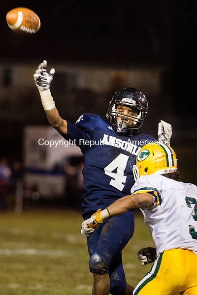 ANSONIA, CT - 7 December 2015-120715EC02-- Ansonia's Tajik Bagley attempts a throw to Tyler Bailey, who was in the end zone Monday night at Ansonia. The pass was incomplete. Trinity Catholic's defender is Jonmichael Bivona. Erin Covey Republican-American.