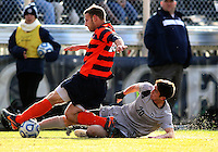 WASHINGTON, DC - NOVEMBER 25, 2012: Andy Riemer (20) of Georgetown University slides into a tackle against Chris Makowski (20) of Syracuse University during an NCAA championship third round match at North Kehoe field, in Georgetown, Washington DC on November 25. Georgetown won 2-1 after overtime and penalty kicks.