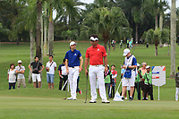 Ross Fisher (Europe) and Yuta Ikeda (Asia) on the 1st green during the Singles Matches of the Eurasia Cup at Glenmarie Golf and Country Club on the Sunday 14th January 2018.<br /> Picture:  Thos Caffrey / www.golffile.ie