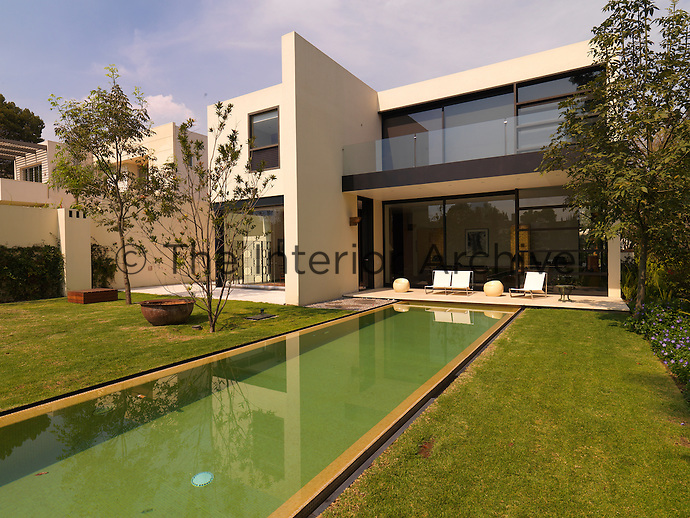 A long narrow lap pool is a focus of the garden at the rear of the property