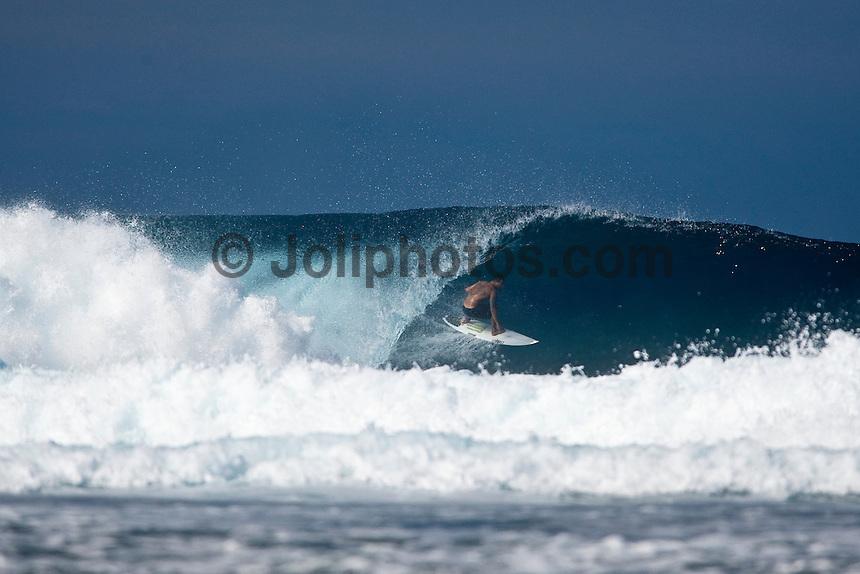 BOBBY MARTINEZ (USA)  inside a barrel at  a reef pass near Teahupoo, Tahiti, (Friday May 15 2009.) Photo: joliphotos.com