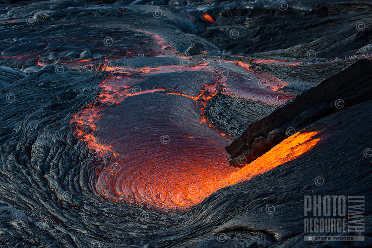 Lava Basin: An overview of lava flowing down into a basin, an extremely hot shot, 61g flow, Hawai'i Volcanoes National Park, Big Island.