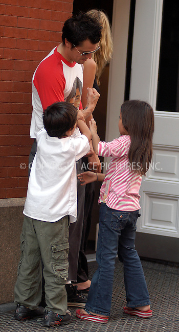 """Men in Black"" star Johnny Knoxville plays with the kids outside his hotel in New York. August 19, 2003. Please byline: NY Photo Press.   ..*PAY-PER-USE*      ....NY Photo Press:  ..phone (646) 267-6913;   ..e-mail: info@nyphotopress.com"