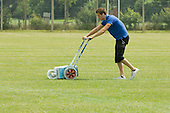 Groundsman marking out white lines for Sports day,  State Secondary Roman Catholic school.