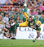 Edmonton Eskimos' Tristan Jackson gets tackled in a game against the Winnipeg Blue Bombers during the first half of CFL action at Edmonton's Commonwealth Stadium on Thursday, July 2, 2009. THE CANADIAN PRESS/Jimmy Jeong