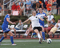 Portland Thorns FC defender Nikki Marshall (7) passes the ball as Boston Breakers defender Rhian Wilkinson (7) closes. In a National Women's Soccer League (NWSL) match, Boston Breakers (blue) defeated Portland Thorns FC (white/black), 2-1, at Dilboy Stadium on August 7, 2013.