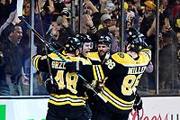 April 25, 2018: Boston Bruins left wing Jake DeBrusk (74) (2nd left) celebrates a goal with teammates during game seven of the first round of the National Hockey League's Eastern Conference Stanley Cup playoffs between the Toronto Maple Leafs and the Boston Bruins held at TD Garden, in Boston, Mass. Boston defeats Toronto 7-4 and wins the best of seven series 4 games to 3 to advance to round two.