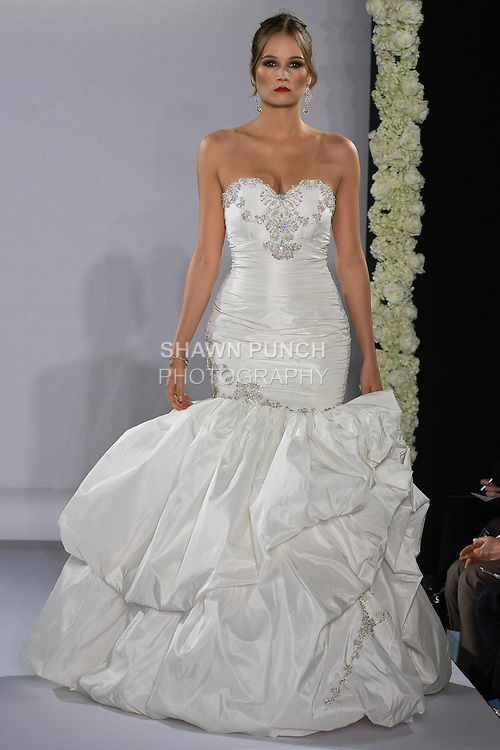 Model walks runway in a Katerina Bocci Bridal gown at the Couture Runway Show, during New York Bridal Fashion Week at The Hilton Hotel, October 13, 2012.