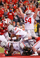 Ohio State Buckeyes quarterback J.T. Barrett (16) dives into the end zone for a one-yard touchdown during the second quarter of the Big Ten Football Championship between the Wisconsin Badgers and the Ohio State Buckeyes on Saturday, December 2, 2017 at Lucas Oil Stadium in Indianapolis. [Joshua A. Bickel/Dispatch]