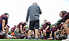 Dan Agovino, North Shore varsity football head coach, talks to his players during practice at North Shore High School in Glen Head on Thursday, Aug. 18, 2016.