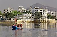 Buildings and palace hotels along shoreline of Lake Pichola, Udaipur, india.
