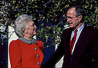 ***FILE PHOTO*** George H.W. Bush Has Passed Away<br /> Washington, DC., USA, November 30, 1989<br /> President George H. W. Bush and his wife Barbara are in the Rose Garden of the White House. <br /> CAP/MPI/MRN<br /> &copy;MRN/MPI/Capital Pictures