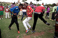 Soweto, South Africa: Izikhothane bling kids in Soweto. 2013. Youth movement who dress up in expensive clothing and drink expensive alcohol. Sometimes they burn the clothes and even money. Photo by: Per-Anders Pettersson