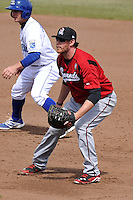 Hunter Morris #25 of the Nashville Sounds takes his defensive stance at first base at Werner Park on April 5, 2014 in Omaha, Nebraska.  The Sounds defeated the Storm Chaser 2-1.  (Dennis Hubbard/Four Seam Images)