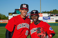 Ronald Guzman (20) and Michael De Leon (1) of the Hickory Crawdads pose for a photo prior to the game against the Kannapolis Intimidators at L.P. Frans Stadium on April 23, 2015 in Hickory, North Carolina.  The Crawdads defeated the Intimidators 3-2 in 10 innings.  (Brian Westerholt/Four Seam Images)
