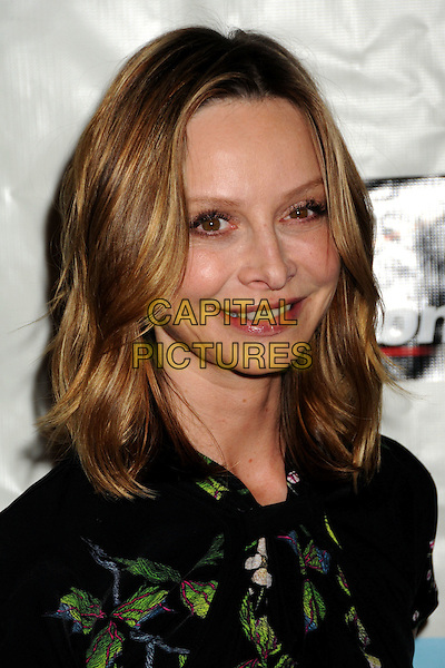 CALISTA FLOCKHART.Attending the 38th Annual Peace Over Violence Humanitarian Awards held at The Beverly Hills Hotel, Beverly Hills, California, USA, 6th November 2009..portrait headshot black green print flower white floral pattern smiling .CAP/ADM/BP.©Byron Purvis/AdMedia/Capital Pictures.