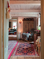 A view through a doorway into the dining room, where a welcome rocking chair awaits you