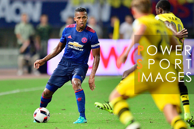 Manchester United winger Antonio Valencia (l) during the International Champions Cup China 2016, match between Manchester United vs Borussia  Dortmund on 22 July 2016 held at the Shanghai Stadium in Shanghai, China. Photo by Marcio Machado / Power Sport Images