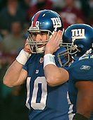 Landover, MD - December 24, 2005 -- New York Giant quarterback Eli Manning (10) struggles to hear the signals during game action against the Washington Redskins at FedEx Field in Landover, MD on December 24, 2005.  The Redskins won the game 35 - 20..Credit: Ron Sachs / CNP.(RESTRICTION: NO New York or New Jersey Newspapers or newspapers within a 75 mile radius of New York City)