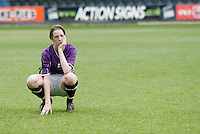 09 MAY 2007 - LONDON, UK - A dejected Brighton player watches as Loughborough celebrate - Loughborough University (Maroon) v Brighton University (Purple) - BUSA Womens Football Championships. (PHOTO (C) NIGEL FARROW)