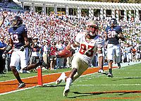 Oct 2, 2010; Charlottesville, VA, USA; Florida State Seminoles wide receiver Bert Reed (83) runs in for a near touchdown between Virginia Cavaliers cornerback Chase Minnifield (13) and Virginia Cavaliers cornerback Devin Wallace (28) during the first half of the game at Scott Stadium.  The play was called back because of holding on the offense. Photo/The Daily Progress/Andrew Shurtleff