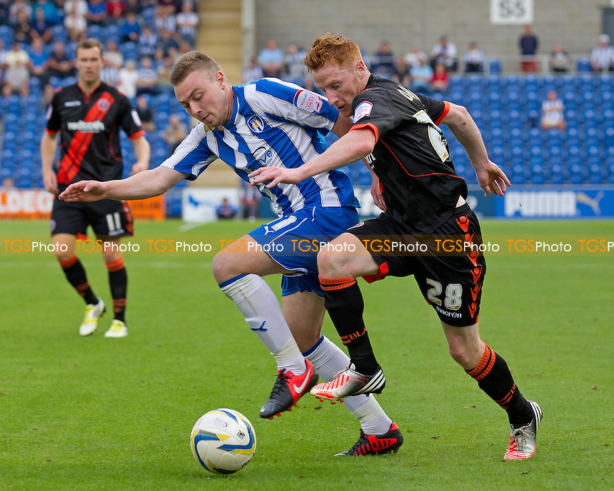 Stephen Quinn, Sheffield United FC tries to shake off the attention of Freddie Sears, Colchester United FC - Colchester United vs Sheffield United - NPower League One Football at the Weston Homes Community Stadium, Colchester, Essex - 25/08/12 - MANDATORY CREDIT: Ray Lawrence/TGSPHOTO - Self billing applies where appropriate - 0845 094 6026 - contact@tgsphoto.co.uk - NO UNPAID USE.