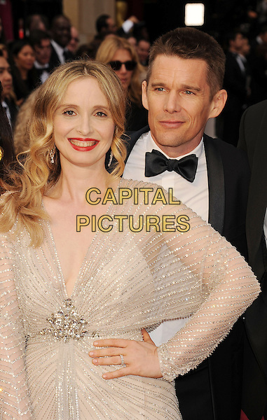 HOLLYWOOD, CA- MARCH 02: Actress/screenwriter Julie Delpy (L) and actor Ethan Hawke attend the 86th Annual Academy Awards held at Hollywood &amp; Highland Center on March 2, 2014 in Hollywood, California.<br /> CAP/ROT/TM<br /> &copy;Tony Michaels/Roth Stock/Capital Pictures