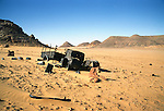 Africa, Libya, Fezzan. Remains of one of three LRDG Chevrolet trucks in a valley of the Gebel Sherif mountains southwest of Kufra. During Second World War on January 31 1941 the Long Range Desert Group was attacked by the Italian Compagnie Sahariane. Libyen 1999/2000.<br /> <br />  --- No releases available. Automotive trademarks are the property of the trademark holder, authorization may be needed for some uses.<br /> <br />  --- INFO: The Long Range Desert Group (LRDG) was a reconnaissance and raiding unit of the British Army during the Second World War. Originally called the Long Range Patrol Unit (LRP), the unit was founded in Egypt in June 1940 by Major Ralph A. Bagnold. Bagnold was assisted by Captain Patrick Clayton and Captain William Shaw. At first the majority of the men were from New Zealand, but they were soon joined by Rhodesian and British volunteers, whereupon new sub-units were formed and the name was changed to the better-known Long Range Desert Group (LRDG).<br /> <br /> The LRDG vehicles were mainly two wheel drive, chosen because they were lighter and used less fuel than four wheel drive. They were stripped of all non-essentials, including doors, windscreens and roofs. They were fitted with a bigger radiator, a condenser system, built up leaf springs for the harsh terrain, wide, low pressure desert tyres, sand mats and channels etc. Initially the LRDG patrols were equipped with one CMP Ford 15 cwt F15 truck for the commander, while the rest of the patrol used up to 10 Chevrolet 30 cwt WB trucks.<br /> <br /> On 31 January 1941 'T' Patrol commanded by Captain Patrick Clayton was attacked by the Compagnia Autosahariana di Cufra, an Italian unit similar to the LRDG, in the Gebel Sherif valley south of Cufra, Libya. The LRDG had one man killed and three men captured, and three of the eleven trucks were destroyed during the battle. The Italians losses were five killed and three wounded, and one truck was abandoned.