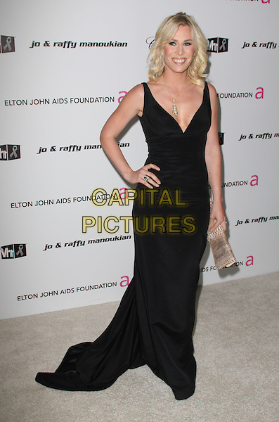 NATASHA BEDINGFIELD.17th Annual Elton John AIDS Foundation Academy Award Viewing Party held at the Pacific Design Center, West Hollywood, California, USA..February 22nd, 2009.oscars full length black dress long maxi hand on hip plunging low cut necklace clutch bag beige snakeskin .CAP/ADM/KB.©Kevan Brooks/AdMedia/Capital Pictures.