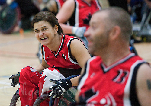 15 AUG 2011 - LEEDS, GBR - Canada's Erika Schmutz jokes with team mate Jared Funk after the wheelchair rugby exhibition match between Great Britain and Canada (PHOTO (C) NIGEL FARROW)
