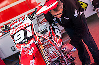 Honda mechanic at Spanish Motocross Championship at Albaida circuit (Spain), 22-23 February 2014