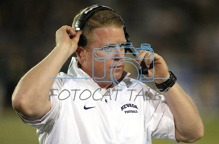 Nevada Head Coach Brian Polian works on the sidelines of an NCAA college football game against Colorado State, in Reno, Nev., on Saturday, Oct. 11, 2014. Colorado State won 31-24. (AP Photo/Cathleen Allison)
