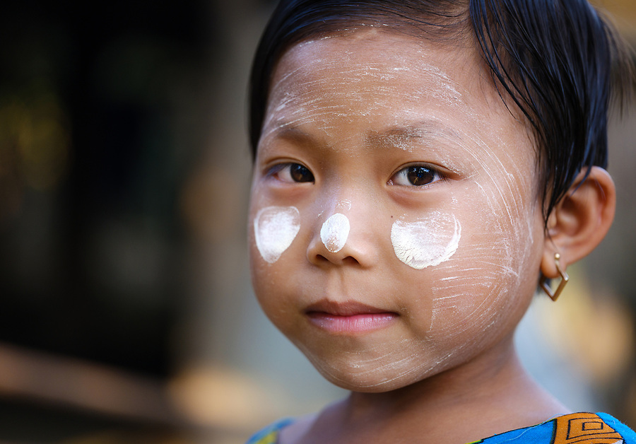 MRAUK U, MYANMAR - CIRCA DECEMBER 2017: Portrait of child wearing typical burmese thanaka  in Mrauk U