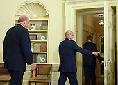Washington, D.C. - May 8, 2006 -- United States President  George W. Bush leads Air Force General Michael Hayden (C) and National Intelligence Director John Negroponte from the Oval Office after Bush named Hayden to be the next Central Intelligence Agency (CIA) Director on May 8, 2006. Hayden will replace Porter Goss if confirmed.  <br /> Credit: Roger Wollenberg - Pool via CNP