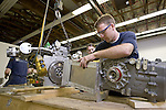 0807-19 091.CR2..0807-19 PACE International Car Assembly..BYU Mechanical Engineering Student Benjamin Pace work on assembling the transaxleto the engine of the PACE car...July 16, 2008..Photo by Jaren Wilkey/BYU..© BYU PHOTO 2008.All Rights Reserved.photo@byu.edu  (801)422-7322