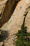 Teen kids climbing Christmas Rock at Cheley Camp, summer, Estes Park, Colorado, not released