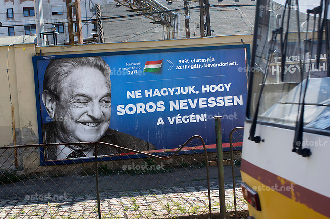 UNGARN, 07.2017, Budapest - VIII. Bezirk. Kampagne der Fidesz-Regierung gegen den US-ungarischen Juden, Finanzspekulanten und Foerderer einer offenen Gesellschaft, George Soros: &quot;Lassen wir nicht zu, dass am Ende Soros lacht!&quot; Darueber in klein: &quot;99% (der Teilnehmer der Propaganda-Volksbefragung &quot;Nationale Konsultation&quot;) lehnen die illegale Einwanderung ab.&quot;  | Fidesz government campaign against the US-Hungarian jew, financial speculator and supporter of an open society, George Soros: &quot;Let's us not allow Soros to laugh in the end!&quot;. Small letters: &quot;99% (of the participants of the propaganda-referendum called &quot;national consultation&quot;) oppose illegal immigration.&quot;  <br /> &copy; Martin Fejer/estost.net
