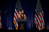 First lady Michelle Obama introduces United States President Barack Obama at a Democratic National Committee (DNC) fundraiser in midtown, Manhattan, New York on Tuesday, September 20, 2011. .Credit: Allan Tannenbaum / Pool via CNP