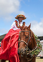 A young pa'u rider in the keiki pa'u unit before the start of the Waimea Paniolo Parade, Big Island.