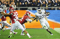 Jan. 1, 2011; Glendale, AZ, USA; Oklahoma Sooners linebacker (12) Austin Box tackles Connecticut Huskies tailback (23) Jordan Todman in the 2011 Fiesta Bowl at University of Phoenix Stadium. The Sooners defeated the Huskies 48-20. Mandatory Credit: Mark J. Rebilas-.