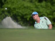 Bethesda, MD - June 28, 2014: Hudson Swatford takes a shot from the bunker on the 14th hole in Round 3 of the Quicken Loans National at the Congressional Country Club in Bethesda, MD, June 28, 2014.  (Photo by Don Baxter/Media Images International)