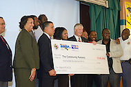 "September 13, 2011 (Prince George's County, MD)   Maryland Lt. Governor Anthony G. Brown (front, second from left)  and the United Way, NCA presented a ceremonial check for $100,000 to community partners who will participate in the one-year pilot program, ""Way to P.E.A.C.E."", (Prevention, Education, Awareness, Connection and Empowerment), in two Prince George's middle schools this fall. An initial $50,000 state grant from the Governor's Office of Crime Control and Prevention (GOCCP) is being matched with $50,000 from the United Way NCA to support the program.  (Photo: Don Baxter/Media Images International)"