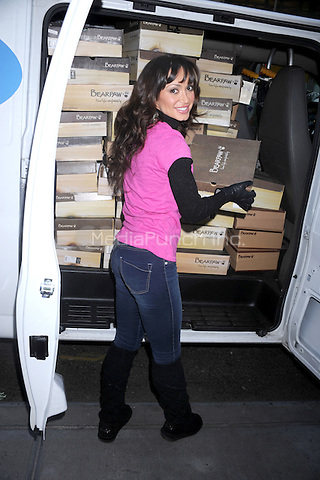Karina Smirnoff donates 1,000 Bearpaw boots to charity at Lady Foot Locker on December 13, 2011 in New York City. © mpi01 / MediaPunch Inc.