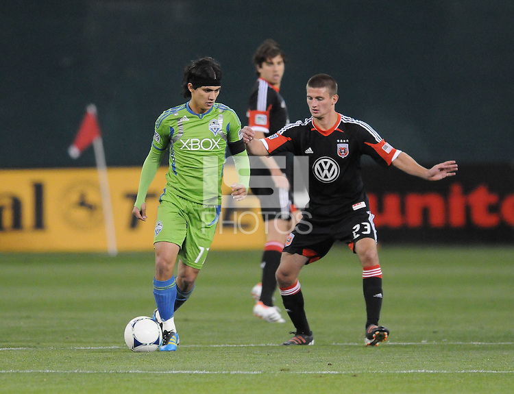 Seattle Sounder forward Freddy Montero (17)  shields the ball against D.C. United midfielder Perry Kitchen (23)  D.C. United tied The Seattle Sounders 0-0 at RFK Stadium, Saturday April 7 , 2012.