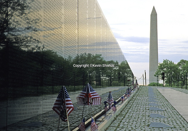The Washington Monument, 555.5 foot tall masonry tower, and the Vietnam Veterans Memorial, two polished granite triangles inscribed with the names of the casualties, in Washington, D.C., USA.