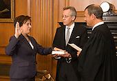Chief Justice John G. Roberts, Jr., administers the Constitutional Oath to Elena Kagan in the Justices' Conference Room on Saturday, August 7, 2010.   Jeffrey P. Minear, Counselor to the Chief Justice, holds the Bible.  Witnesses included Marc and Irving Kagan (brothers) and Justices John Paul Stevens, Anthony Kennedy, Clarence Thomas, Ruth Bader Ginsburg and Sonia Sotomayor (not pictured).  .Mandatory Credit: Steve Petteway - US Supreme Court via CNP